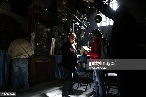 Foreign Christian worshipers wait in line to pray in front of icons at the Church of the Nativity revered as the site of Jesus Christ's birth in the...