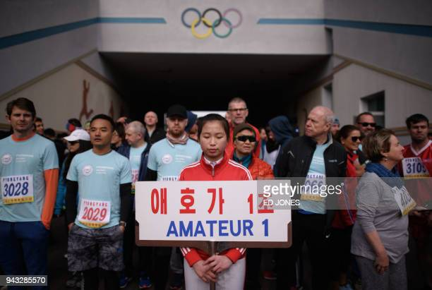 Foreign competitors gather at an entrance of Kim Il Sung stadium prior to the annual Pyongyang marathon on April 8 2018 The event part of the...