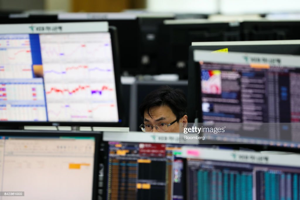 A foreign currency dealer looks at a monitor in a dealing room of