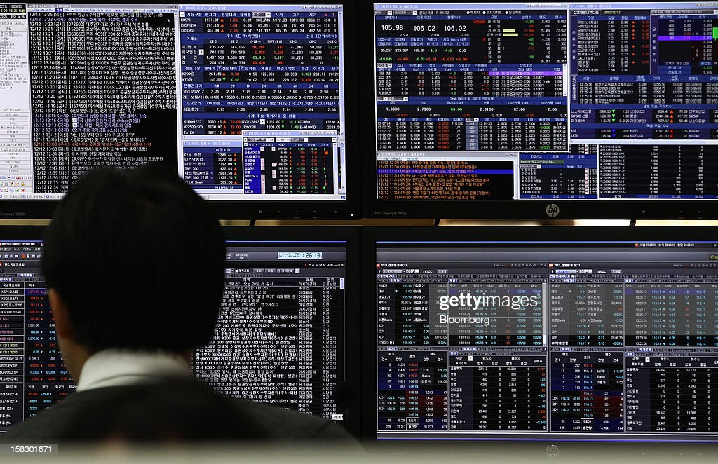 A foreign currency dealer monitors trade data in a dealing room at the Korea Exchange Bank headquarters in Seoul, South Korea, on Wednesday, Dec. 12, 2012. South Korea's won traded near a 15-month high and stocks extended gains after North Korea launched a rocket in defiance of international sanctions. Photographer: SeongJoon Cho/Bloomberg via Getty Images
