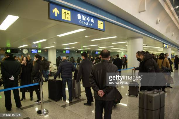 Foreign diplomats embassy staff and their families checkin for a flight to Vladivostok at Pyongyang International Airport on March 9 2020 Several...