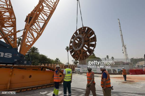 Foreign engineers work on May 4 2016 at a construction site of a section of the Saudi capital Riyadh's $225 billion metro system The system which...
