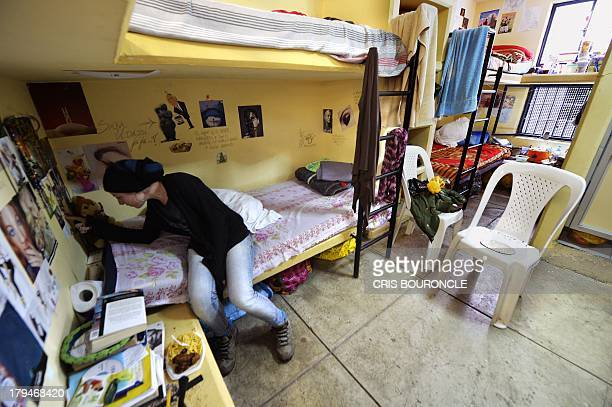 A foreign female inmate sits on her bunk bed at the Ancon 2 prison part of the Piedras Gordas Model Penitentiary complex about 12 km north of Lima on...