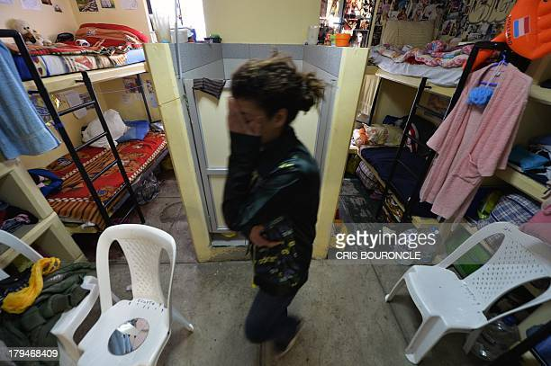 A foreign female inmate walks in her cell at the Ancon 2 prison part of the Piedras Gordas Model Penitentiary complex about 12 km north of Lima on...