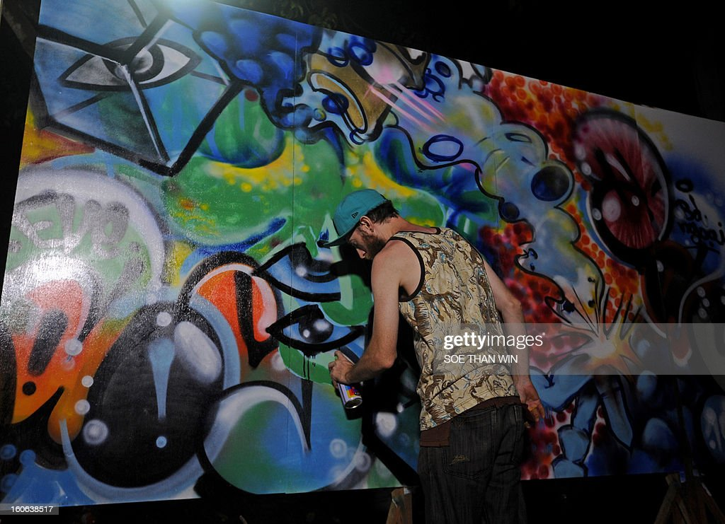 A foreign graffiti artist paints a mural in Yangon on February 4, 2013. AFP PHOTO/ Soe Than WIN