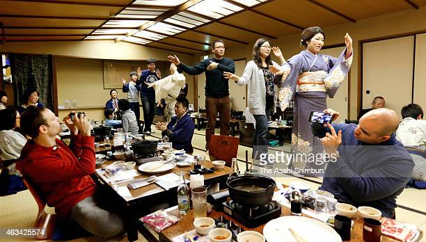 Foreign guests dance with geisha during an ozashiki dining session at the Ichinoyu Honkan inn on January 12 2015 in Hakone Kanagawa Japan Ichinoyu...