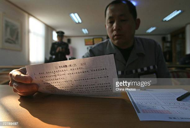 A foreign inmate attends the Hanyu Shuiping Kaoshi test at the Shanghai Qingpu Prison on December 10 2006 in Shanghai China HSK test or the Chinese...