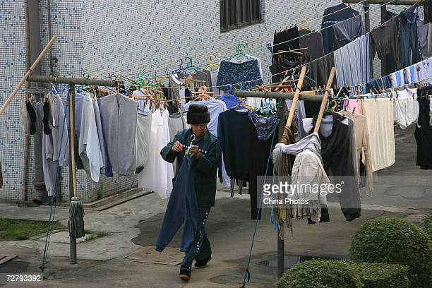 A foreign inmate dries clothes in the sun at the Shanghai Qingpu Prison on December 10 2006 in Shanghai China As the only local prison of the city...