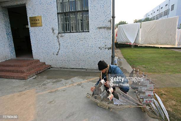 A foreign inmate makes a sailboat model as preparation for Christmas at the Shanghai Qingpu Prison on December 10 2006 in Shanghai China As the only...