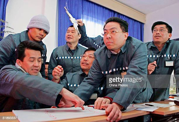 Foreign inmates attend a Chinese cultural competition during an evening held by the Shanghai Qingpu Prison to celebrate Christmas on December 24 2004...