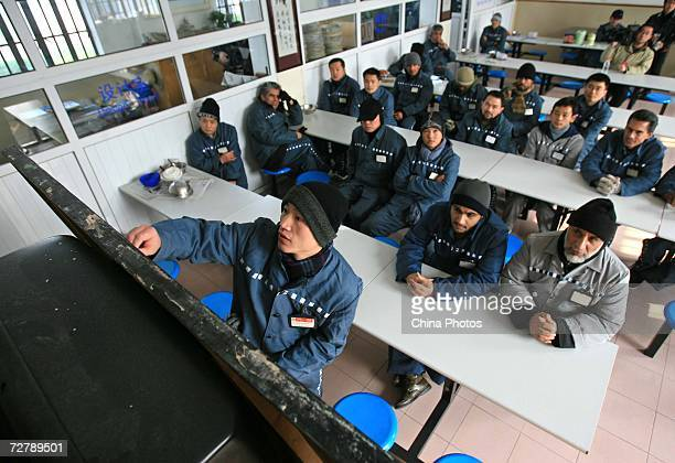 Foreign inmates attend a Chinese lesson after six of them finished the Hanyu Shuiping Kaoshi test at the Shanghai Qingpu Prison on December 10 2006...
