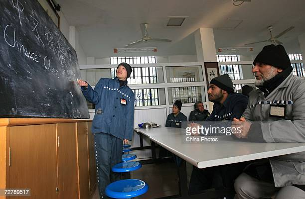 Foreign inmates attend a Chinese lesson after six of them finished Hanyu Shuiping Kaoshi test at the Shanghai Qingpu Prison on December 10 2006 in...