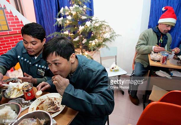 Foreign inmates of the Shanghai Qingpu Prison eat dinner during an evening held by the prison to celebrate Christmas on December 24 2004 in Shanghai...