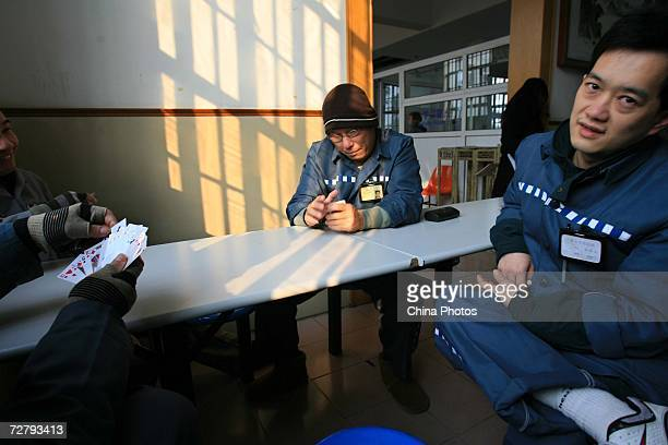 Foreign inmates play cards at the Shanghai Qingpu Prison on December 10 2006 in Shanghai China As the only local prison of the city that holds...