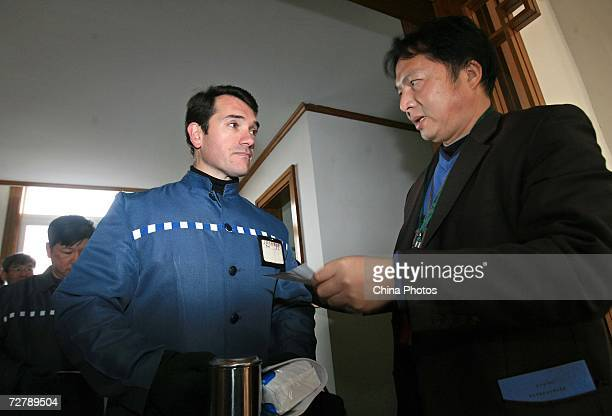 Foreign inmates queue to enter the test room to attend the Hanyu Shuiping Kaoshi test at the Shanghai Qingpu Prison on December 10 2006 in Shanghai...