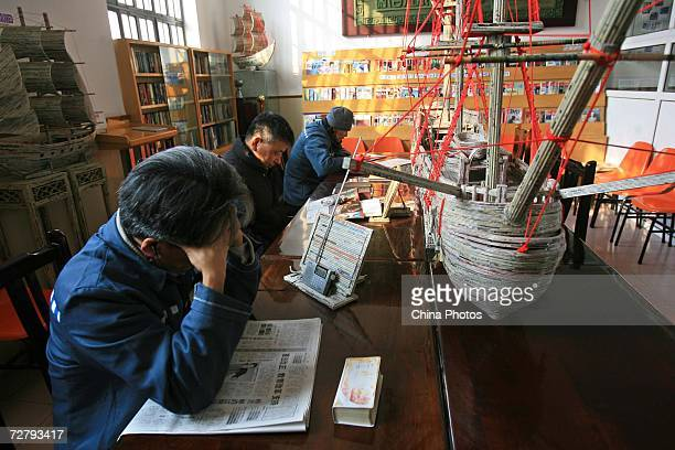 Foreign inmates read newspapers at the Shanghai Qingpu Prison on December 10 2006 in Shanghai China As the only local prison of the city that holds...