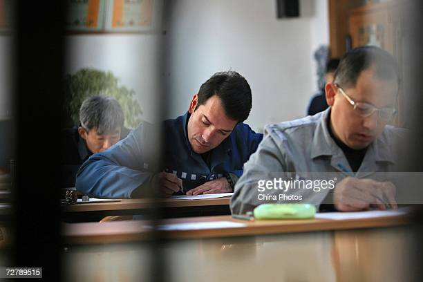 Foreign inmates take the Hanyu Shuiping Kaoshi test at the Shanghai Qingpu Prison on December 10 2006 in Shanghai China HSK test or the Chinese...
