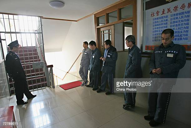 Foreign inmates wait to take the Hanyu Shuiping Kaoshi test at the Shanghai Qingpu Prison on December 10 2006 in Shanghai China HSK test or the...