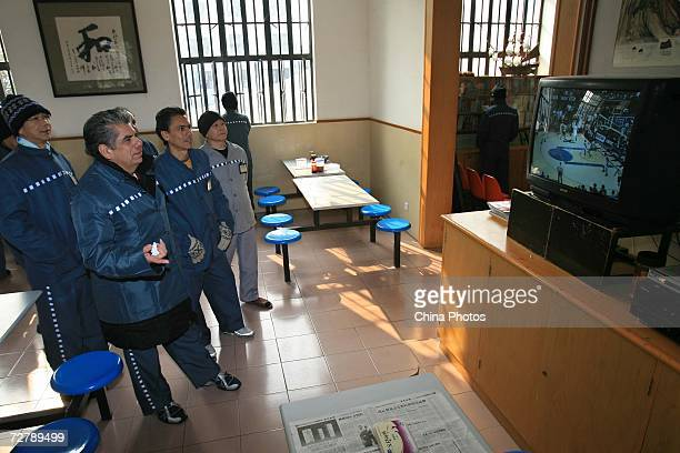 Foreign inmates watch a basketball match after finishing the Hanyu Shuiping Kaoshi test at the Shanghai Qingpu Prison on December 10 2006 in Shanghai...