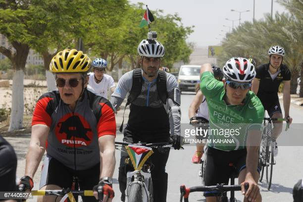 Foreign Israeli and Palestinian cyclists ride in the center of the Palestinian West Bank city of Jericho during the fifth and final day of the Middle...