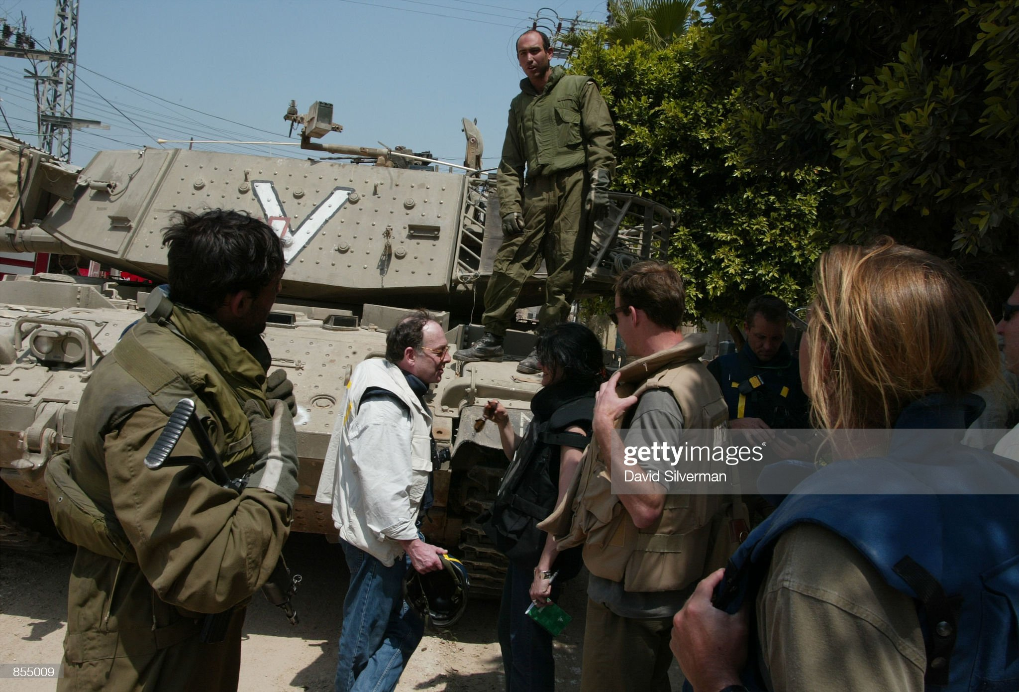 https://media.gettyimages.com/photos/foreign-journalists-are-stopped-between-by-an-israeli-tank-crew-in-picture-id855009?s=2048x2048