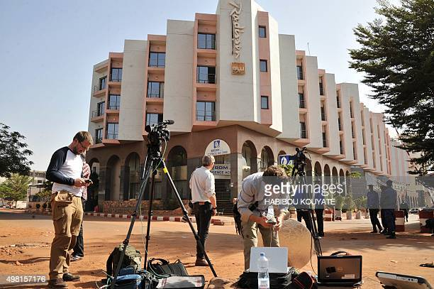 Foreign journalists work outside the Radisson Blu hotel in Bamako on November 21 2015 Investigators in Mali are hunting at least three people...