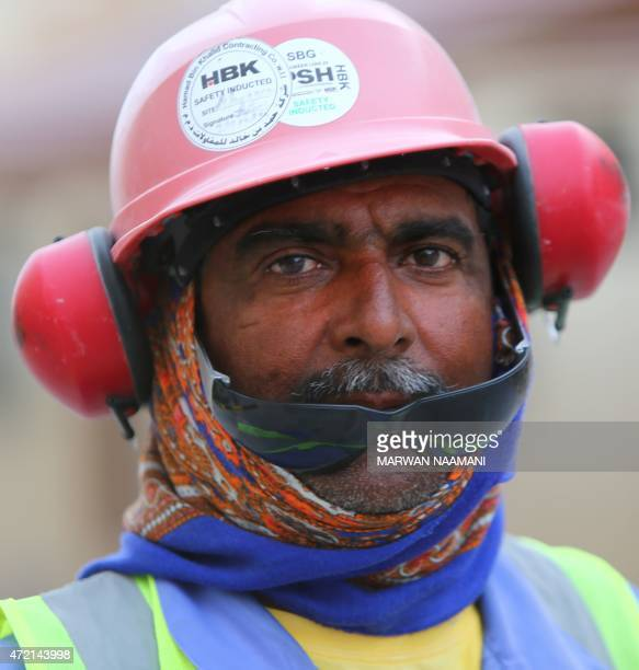 A foreign laborer working on the construction site of the alWakrah football stadium one of the Qatar's 2022 World Cup stadiums walks back to his...