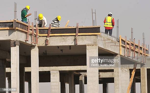 Foreign laborers work at a construction site in the Saudi capital Riyadh on October 30 2013 Oilrich Saudi Arabia a magnet for mostly poor Asian...