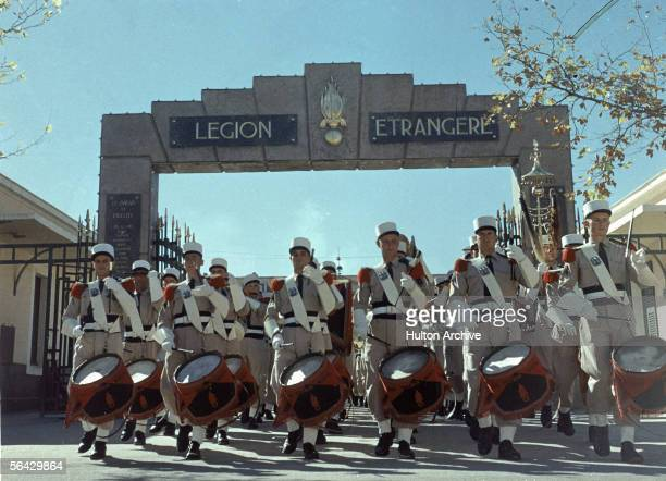 Foreign Legion soldiers drum in formation a parade before the gates of the Legion's headquarters in Sidi Bel Abbes Algeria 1940s