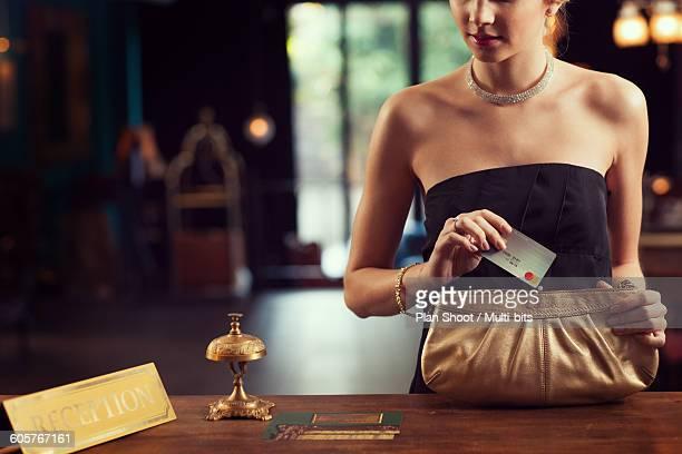 foreign man and woman at hotel front - pochette borsetta foto e immagini stock