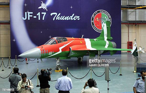 Foreign media cameramen film the newly manufactured multirole light weight fighter aircraft the JF17 Thunder jointly built by Pakistan and China and...