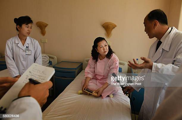 Foreign media interview an alleged patient at the Pyongyang Maternity Hospital in Pyongyang North Korea on May 7 2016