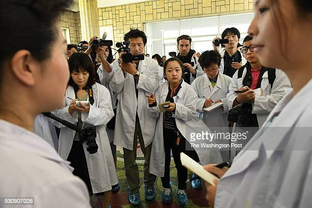 Foreign media listen to a presentation during a tour of the Pyongyang Maternity Hospital in Pyongyang North Korea on May 7 2016 Media was forced to...