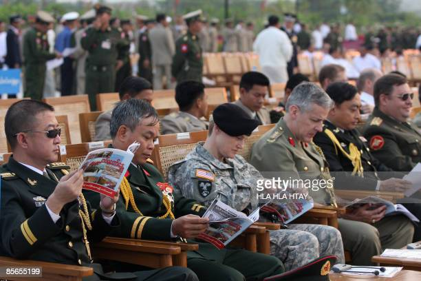 Foreign military attaches from the embassies of China Russia US Japan and other Aisan countries attend Myanmar's army parade during the Armed Forces...