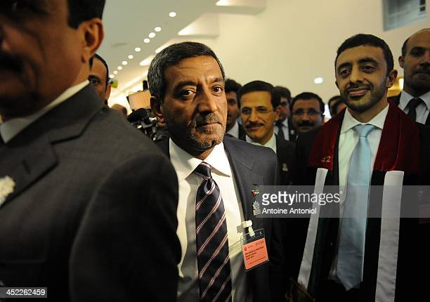 Foreign Minister Abdullah bin Zayed alNahyan and Sheikh Ahmed Bin Saeed alMaktoum chairman of the Dubai Economic Sector Committee react after the...