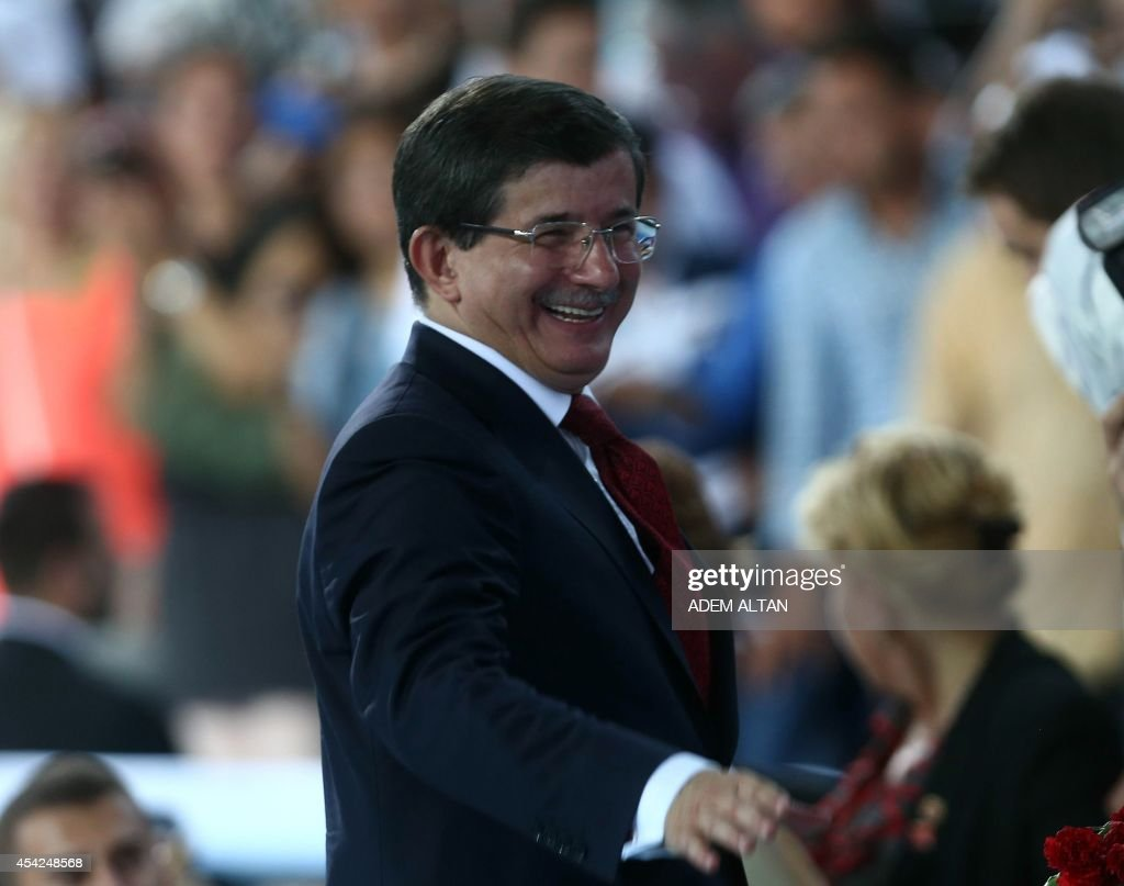 Foreign Minister Ahmet Davutoglu waves at AKP party members during their extraordinary party congress in Ankara on August 27, 2014. Davutoglu was elected as head of the party, replacing president elect Recep Tayyip Erdogan.