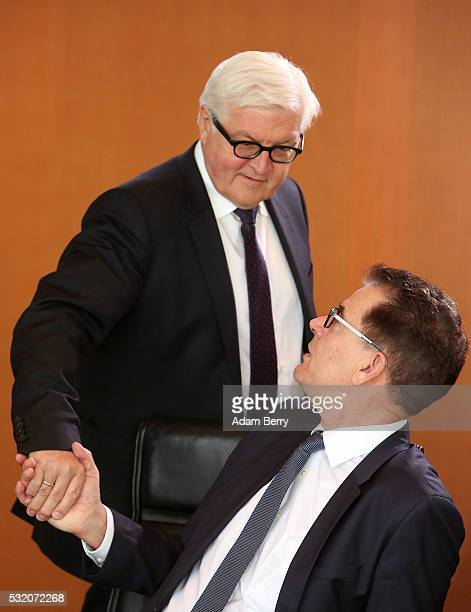 Foreign Minister FrankWalter Steinmeier and Development Minister Gerd Mueller arrive for the weekly German federal Cabinet meeting on May 18 2016 in...
