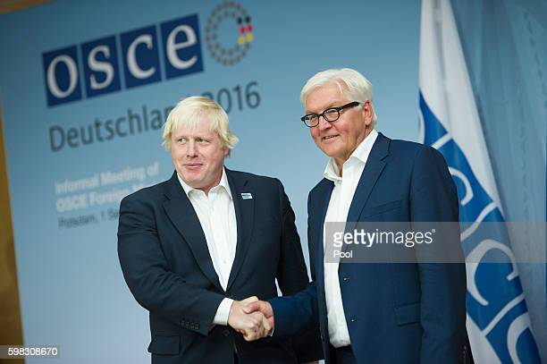 Foreign Minister FrankWalter Steinmeier and his British counterpart Foreign Secretary Boris Johnson attend a conference of OSCE members states on...
