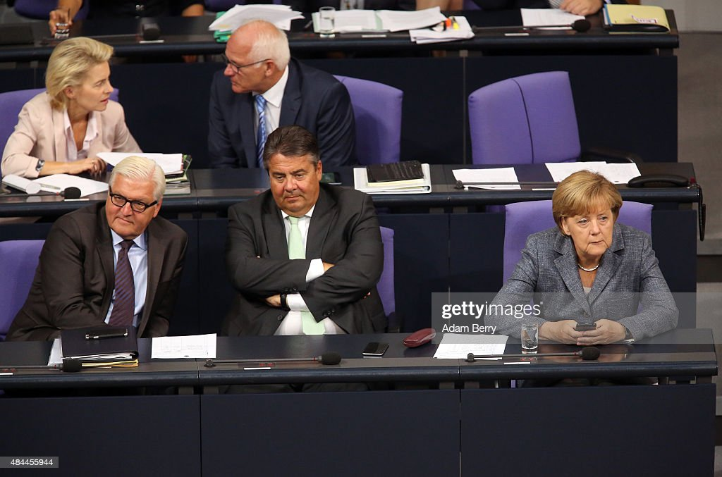 Foreign Minister Frank-Walter Steinmeier (SPD), Vice Chancellor and Economy and Energy Minister Sigmar Gabriel (SPD) and German Chancellor Angela Merkel (CDU) attend a meeting of the German federal parliament, or Bundestag, on August 19, 2015 in Berlin, Germany. European governments vote this week on a third bailout package for economically-troubled Eurozone member Greece. Merkel and the country's finance minister, Wolfgang Schaeuble, have encouraged German parliamentarians to support the latest plan, evaluated at 86 billion euros (USD 95.5 billion). Meanwhile the leaders praised the Greek government for accepting German prerequisites for the offer, and have assured that the International Monetary Fund (IMF) would participate in the latest bailout package.