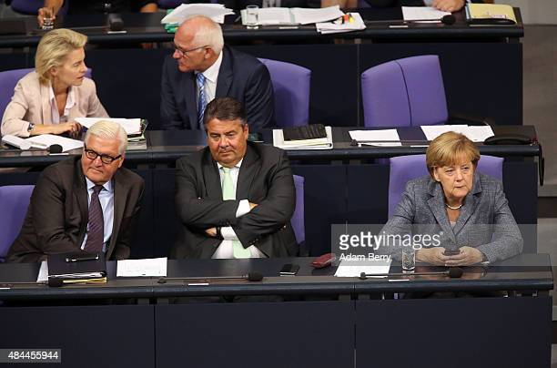 Foreign Minister FrankWalter Steinmeier Vice Chancellor and Economy and Energy Minister Sigmar Gabriel and German Chancellor Angela Merkel attend a...