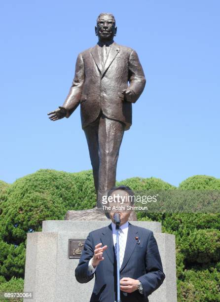Foreign Minister Fumio Kishida speaks in front of the statue of Hayato Ikeda during the 60th anniversary of the foundation of the 'Kochikai' ruling...