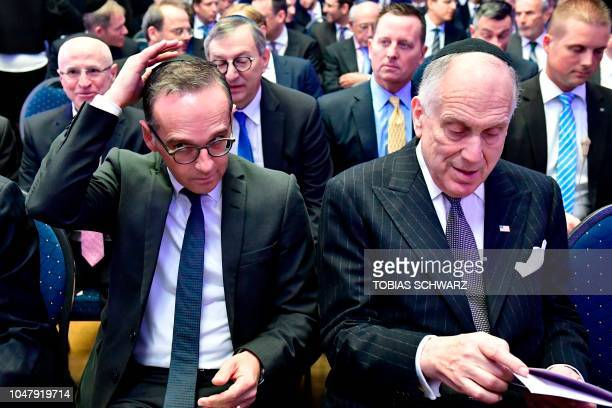 Foreign minister Heiko Maas adjusts his Jewish kippa skullcap next to the President of the World Jewish Congress Ronald Lauder prior the solemn...