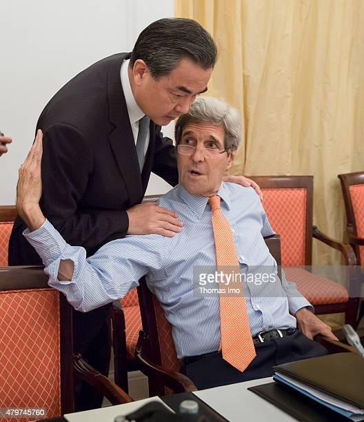 Foreign Minister John Kerry speaks to Wang Yi Foreign Minister of China during the nuclear talks between the E33 and Iran on July 07 2015 in Vienna...