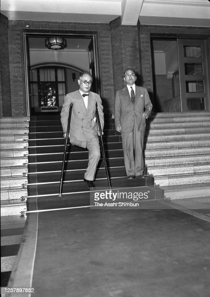 Foreign Minister Mamoru Shigemitsu and Shunichi Matsumoto are seen at the Imperial Palace after visiting the Soviet Union on September 3, 1956 in...