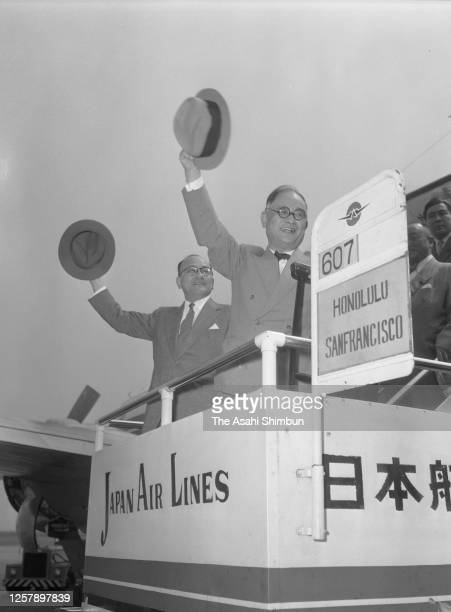 Foreign Minister Mamoru Shigemitsu and Shunichi Matsumoto wave on arrival after visiting the Soviet Union at Haneda Airport on September 3, 1956 in...