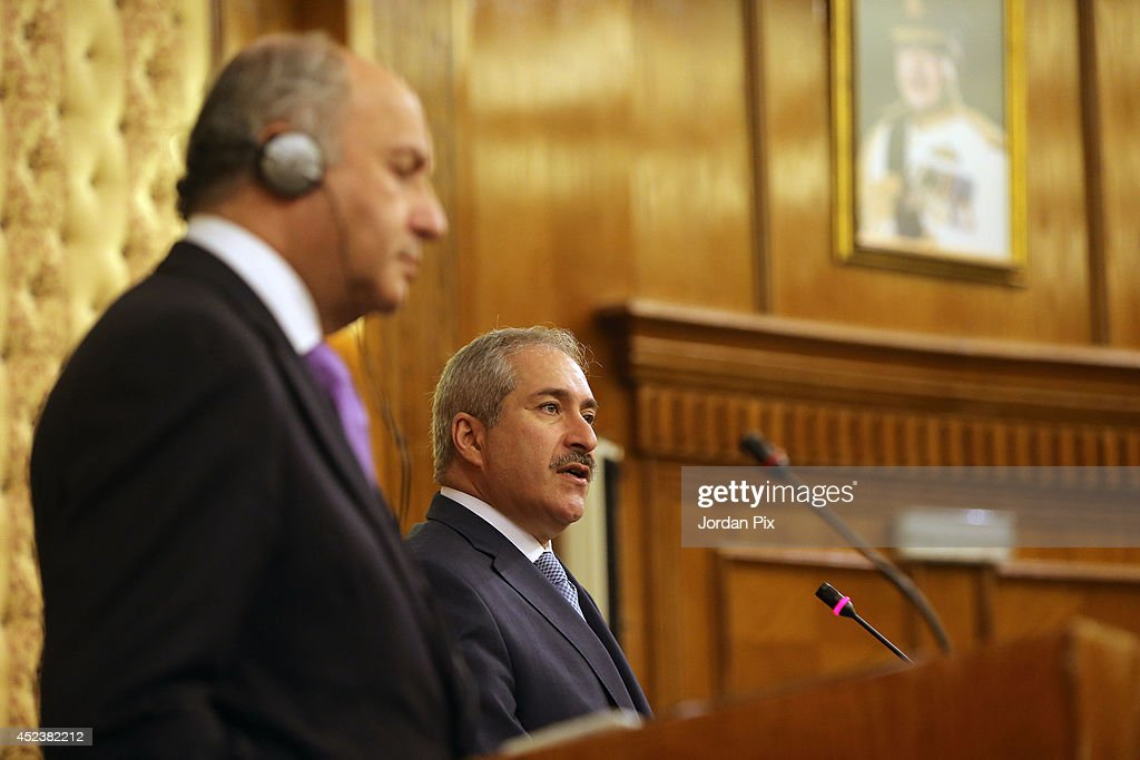 Foreign Minister of France Laurent Fabius (L) holds a press conference with his Jordanian counterpart Nasser Judeh upon his arrival for talkson July 19, 2014, in Amman, Jordan.