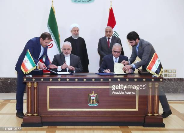 Foreign Minister of Iran Javad Zarif and Iraqi Foreign Minister Mohamad Alhakim sign a memorandum of understanding in the presence of Iranian...