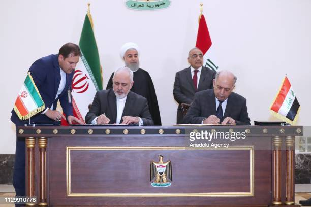 Foreign Minister of Iran Javad Zarif and Iraqi Oil Minister Samir Gadban attend a signing ceremony in the presence of Iranian President Hassan...