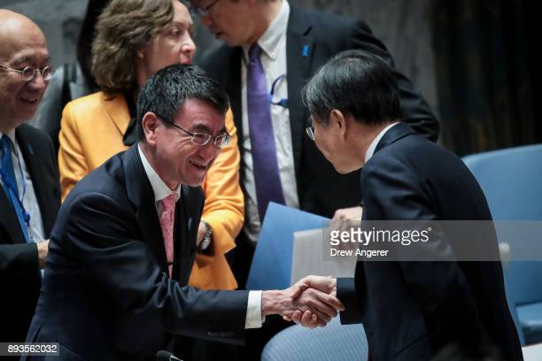 Foreign Minister of Japan Taro Kono shakes hands with South Korean Vice Foreign Minister Cho Hyun during a United Nations Security Council meeting...