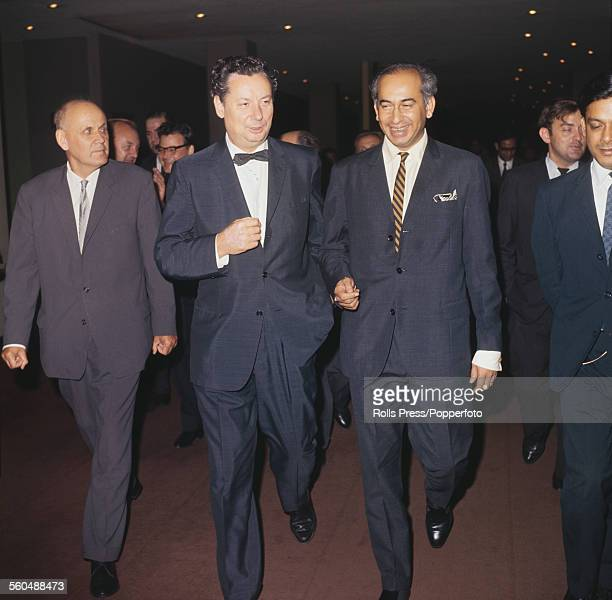 Foreign Minister of Pakistan Zulfikar Ali Bhutto pictured right conferring with Soviet ambassador at the United Nations Nikolai Fedorenko in centre...